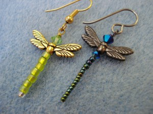 two dragonfly earrings made in different styles using seed beads